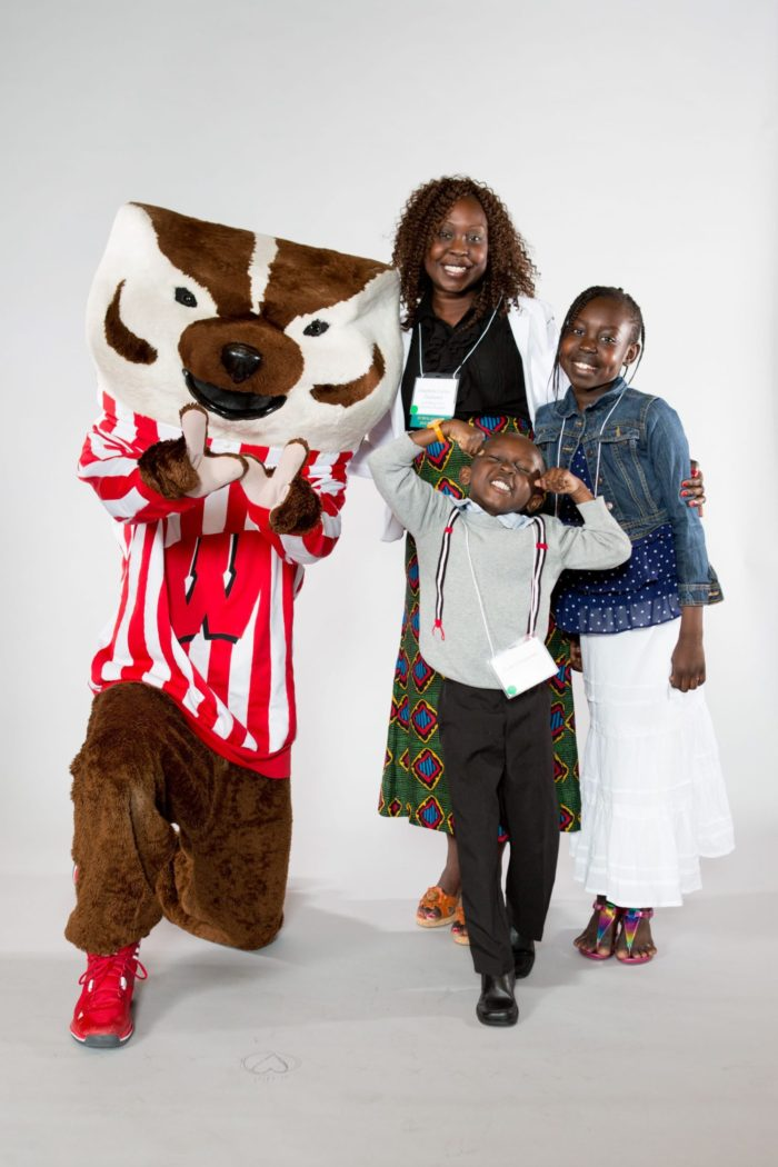Scholarship recipient with her family and Bucky