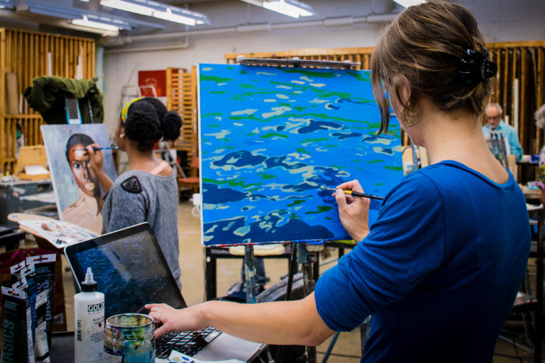 ACSSS Students painting in class