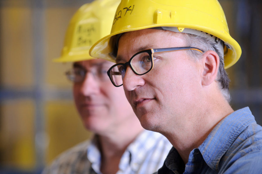 serious looking person wearing yellow construction hard hat