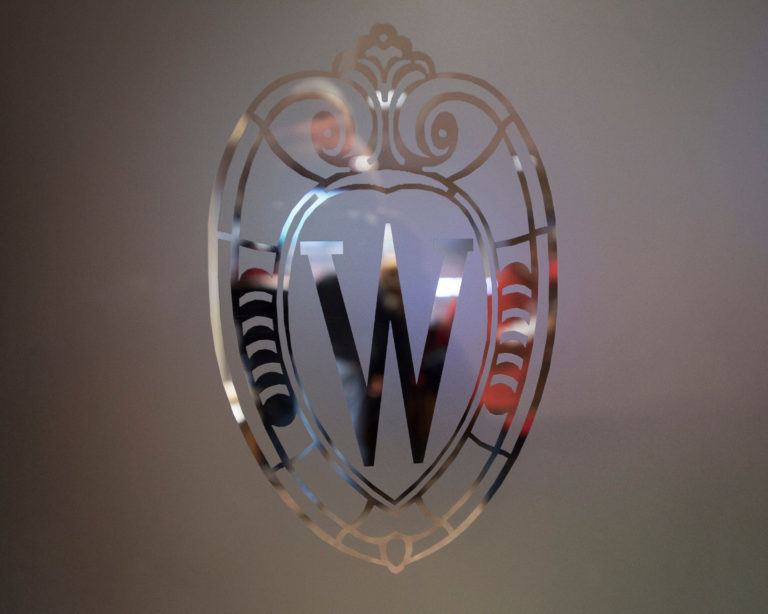 glass-etched Wisconsin crest