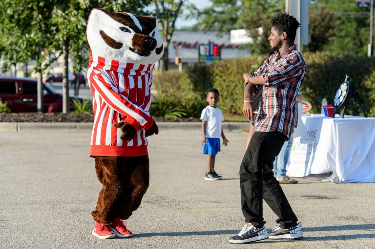 Bucky dancing with young man