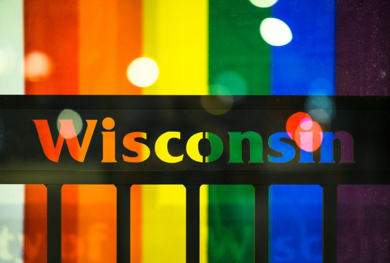 Wisconsin sign with rainbow flag